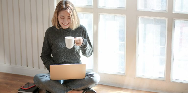 woman-in-gray-sweater-drinking-coffee-sending-email-online-marketing